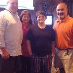 Bryce with his parents at year end Growler party at Sharky's